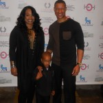 Singer Tony Terry with his wife and son
