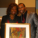 Omari Hardwick (Rising Star Award) with Kathleen Bertrand.