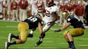 Jan. 7, 2013: Alabama's Eddie Lacy spins past Notre Dame's Dan Fox (48) and Danny Spond for a touchdown during the first half of the BCS National Championship college football game. (AP)