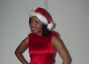 """Sonya Jenkins in """"Santa"""" Satin Red."""