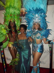 Miss Bahamas 2012 Celeste Marshal (far left) and Miss Black US Ambassador 2013 Jazmine Ayanna Scroggins (far right) - posing with Sonya Jenkins (mid) - led the Parade of Masks.
