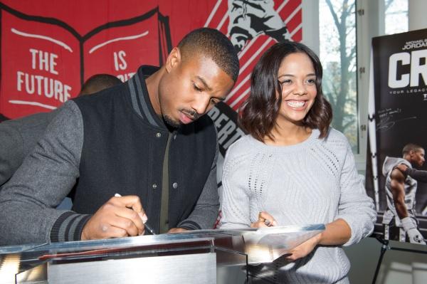 CREED stars Michael B. Jordan and Tessa Thompson signing autographs during the Big Brothers Big Sisters of Metro Atlanta mural unveiling on November 10