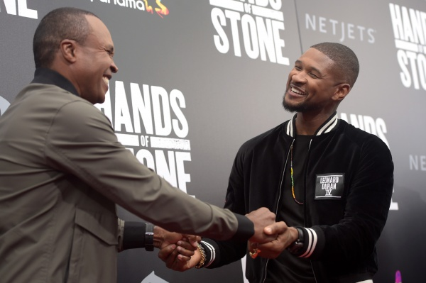 "Former professional boxer, Sugar Ray Leonard (L) and Usher attend the New York Premiere Of ""Hands Of Stone"" in Partnership with DeLeon Tequila, NetJets, The Redbury New York and VisitPanama at SVA Theater on August 22, 2016 in New York City. (Photo by Jason Kempin/Getty Images for The Weinstein Company)"