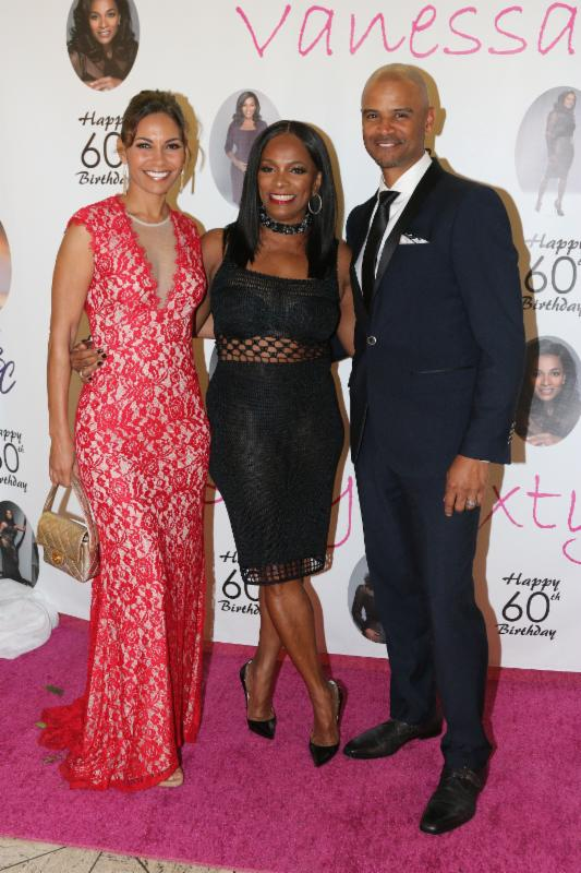 Salli Richardson Whitfield, Vanessa Bell Calloway and Dondre Whitfield on the carpet.