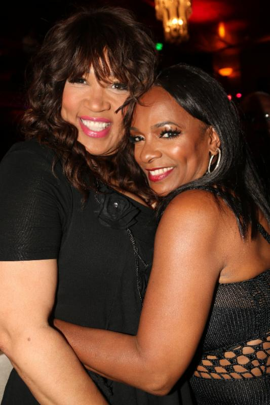 Kym Whitley and Vanessa Bell Calloway are all smiles and hugs.