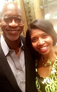 Former Track Star Edwin Moses poses with Sonya Jenkins