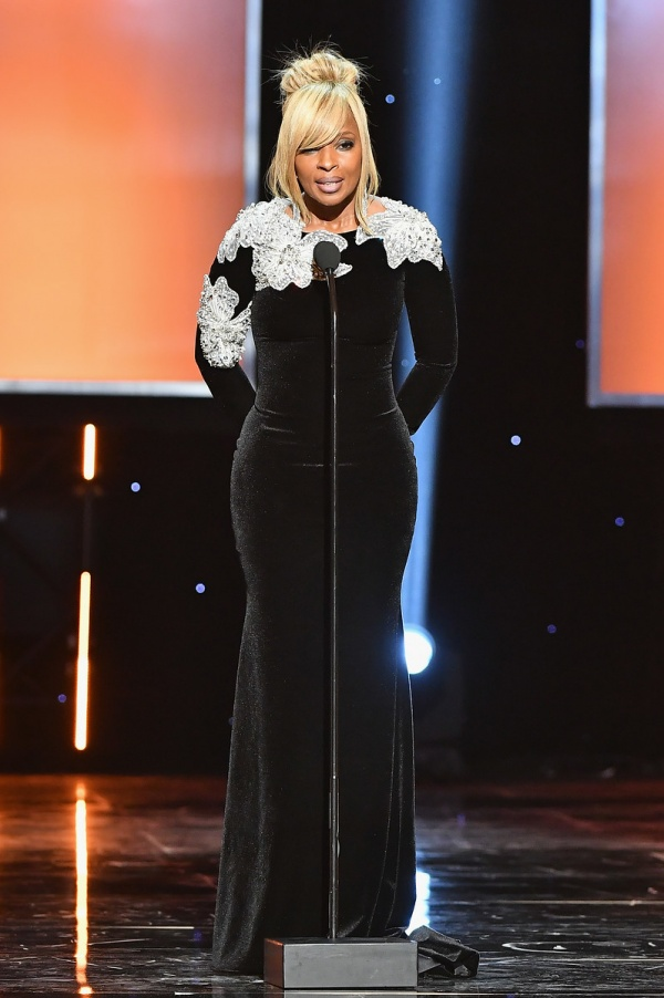 Mary J. Blige speaks onstage
