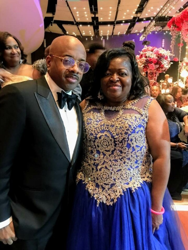 Diane Larche poses with Jermaine Dupri, who donated $50,000 during the fund to mission at the 35th Annual UNCF Atlanta Mayor's Masked Ball.
