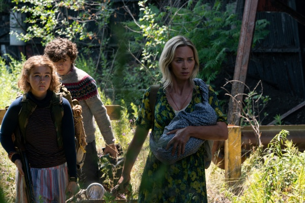 """L-r, Regan (Millicent Simmonds), Marcus (Noah Jupe) and Evelyn (Emily Blunt) brave the unknown in """"A Quiet Place Part II.""""  Photo Credit Jonny Cournoyer"""